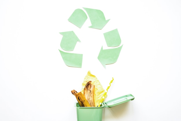 Recycle symbol with garbage bin