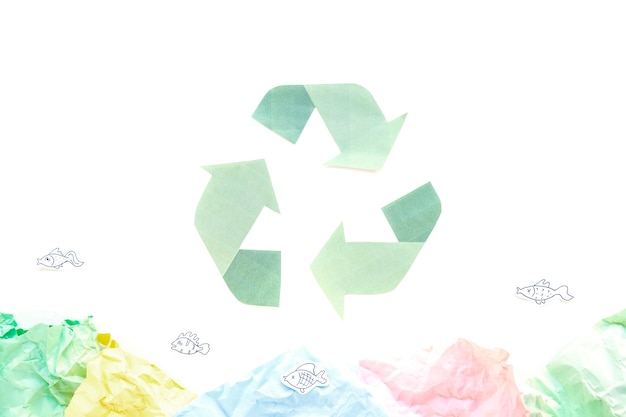 Recycle symbol with papers