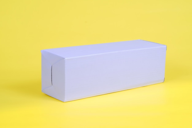 Recycle white cardboard storage box on a color background