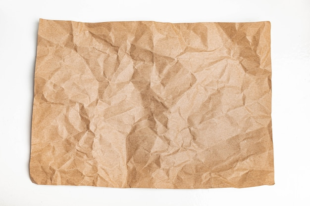 Recycled brown wrinkle crumpled old with paper page texture rough background.