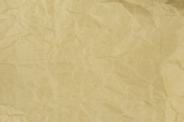 Recycled crumpled light brown paper texture or paper background for design with copy space