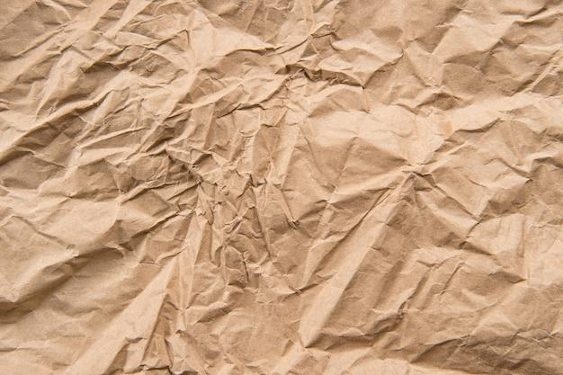 Текстура переработанной бумаги. оберточный крафт-материал. абстрактная природа цветной фон
