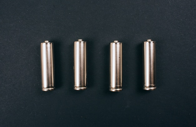 Recycling, reuse, reduce concept. single-use silver batteries in the row, top view. protect an environment. single-use electric waste