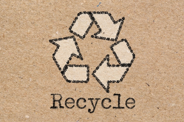 Recycling symbol on brown craft paper texture or background