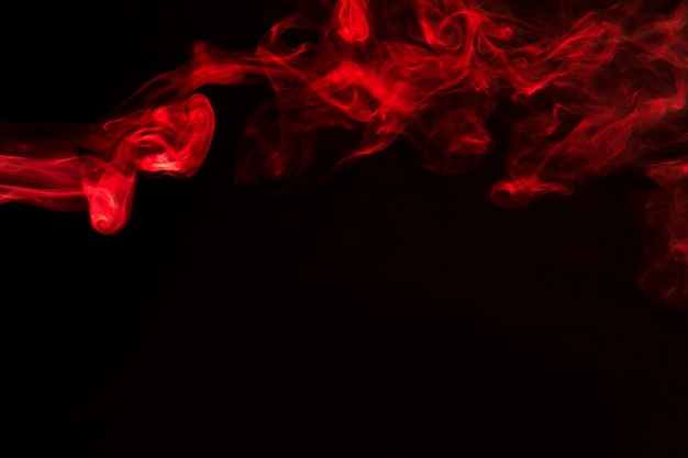 Red abstract smoke curves and wave on black background
