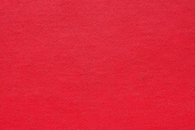 背景の赤い抽象的なテクスチャ。テクスチャ装飾素材、パンフレット、ポスター、表紙、カタログのパターン背景デザインのクローズアップ詳細マクロ写真ビュー。
