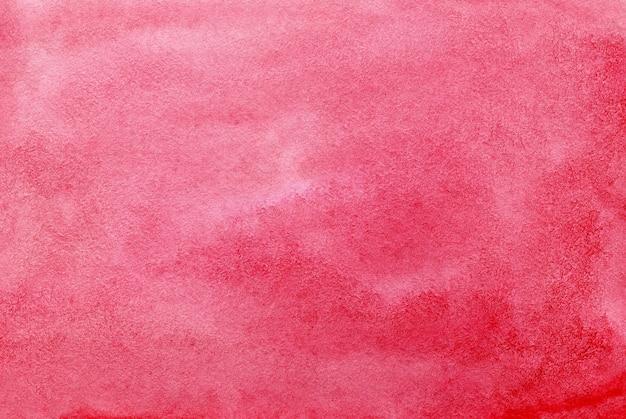 テクスチャードペーパー上の赤い抽象的な水彩画の背景