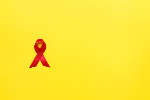 Red aids awareness ribbon. world aids day and healthcare and medicine concept