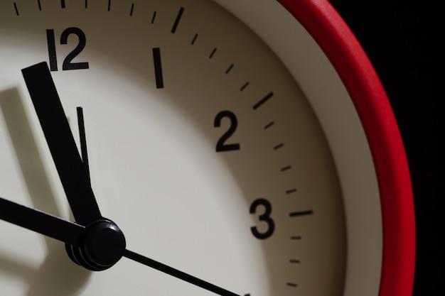 Red alarm clock close up