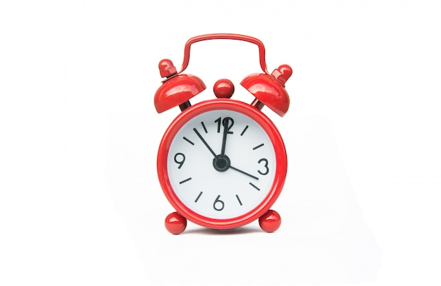Red alarm clock isolated on white background with clipping path