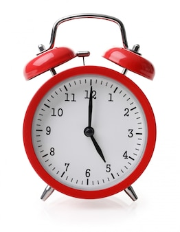 Red alarm clock set at five isolated over white background