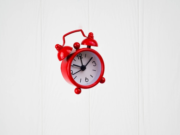 Red alarm clock on white