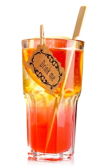 Red alcohol cocktail in glass with orange slice isolated