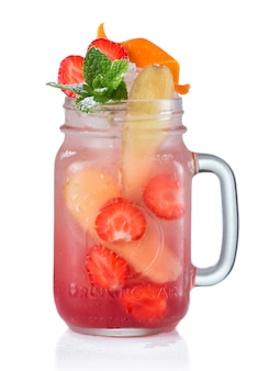 Red alcohol cocktail with fruits in drinking jar