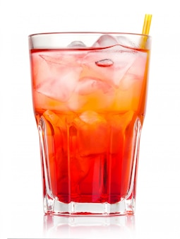 Red alcohol cocktail with ice and straw isolated