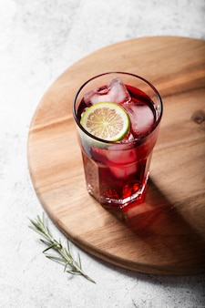 Red alcoholic cocktail with lemon