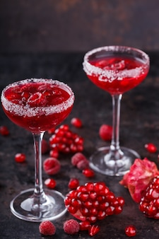Red alcoholic cocktail with raspberry. summer drink for parties.
