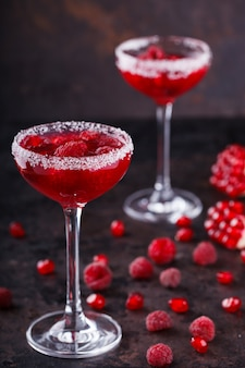 Red alcoholic cocktail with raspberry .summer party drink.
