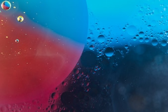 Red and blue abstract background with bubbles