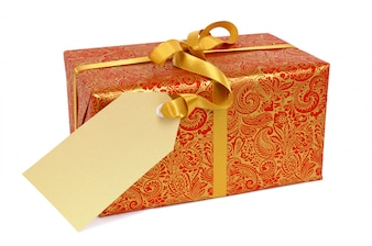 Red and gold gift with ribbon and tag.