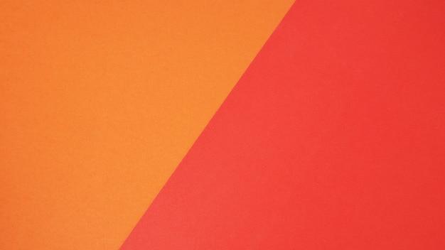 배경을 위한 빨간색과 주황색 색지그것은 빈 공간이고 사람이 없습니다