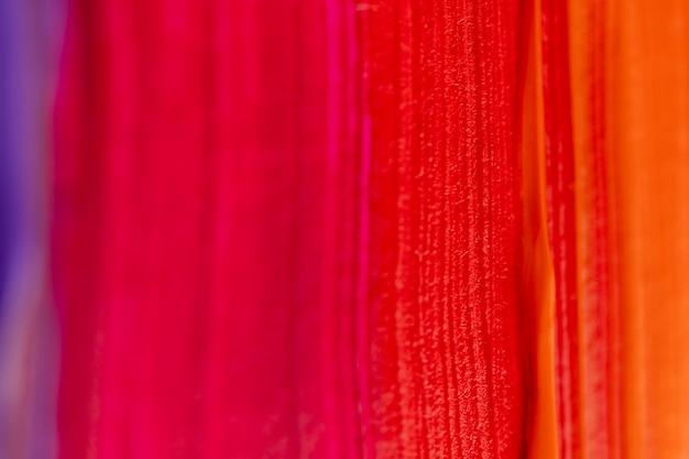 赤とオレンジのペイントストローク