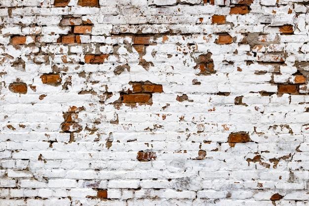 Красно-белая гранжевая кирпичная стена
