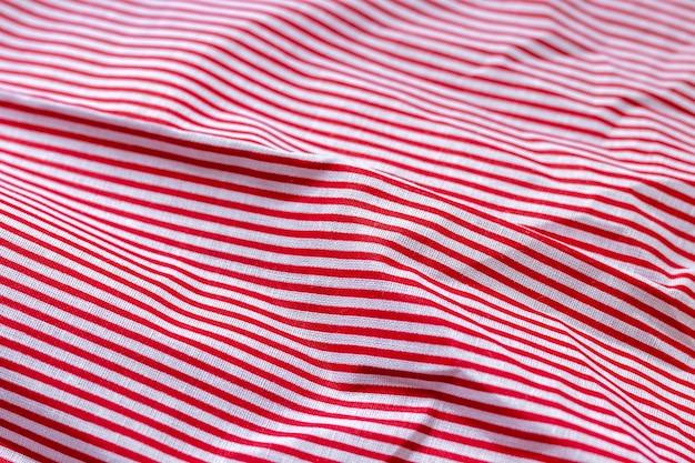赤と白の縞模様の生地の質感の綿の背景