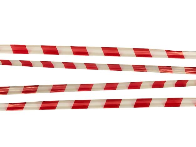 Красные и белые предупреждающие полосы на заградительной ленте запрещают проезд. барьерная лента на белом изоляте. барьер, запрещающий движение. предупреждение об опасной опасной зоне: не входить. концепция запрета входа. копировать пространство