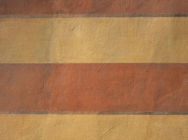 Красная и желтая штукатурка текстуры фона