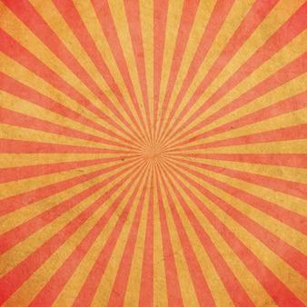 赤と黄色のサンバーストヴィンテージとパターンの背景とスペース。