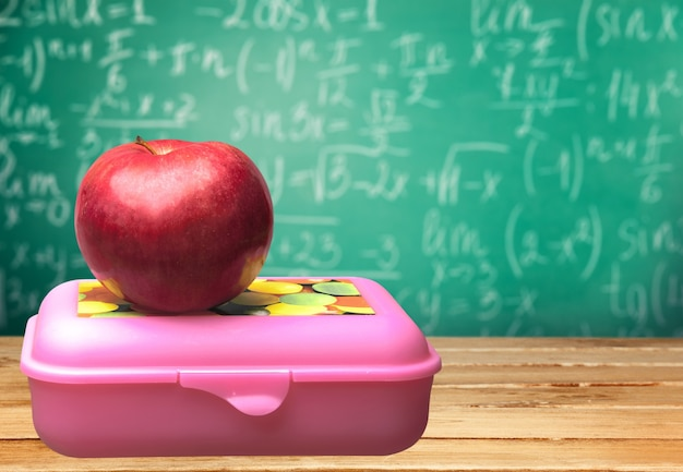 Red apple and food on the  desk