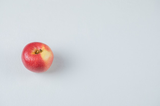 Red apple isolated on the textured surface