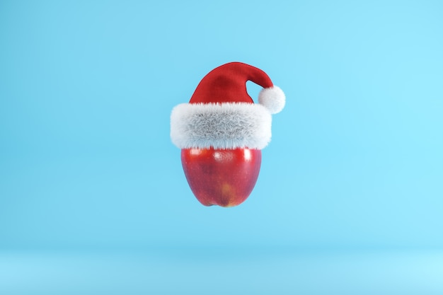 Red apple with santa hat floating on blue