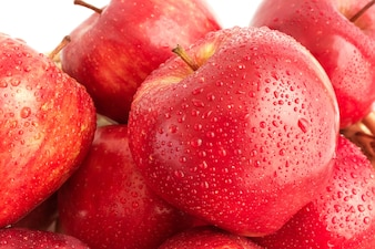 Red apple with water drop in closeup shot