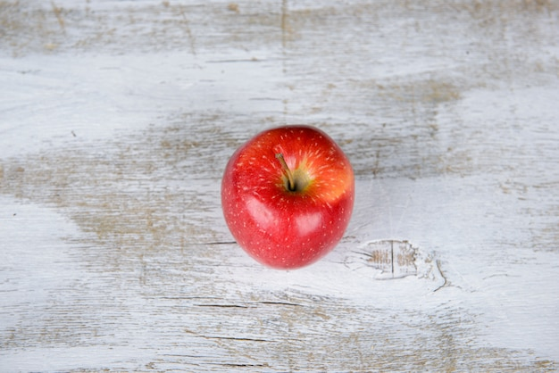 Red apple on a wooden background