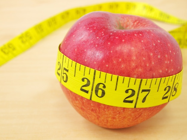Red apple and yellow measure, healthcare and diet concept