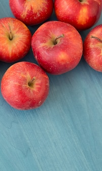 Red apples on a blue table
