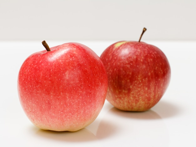Red apples close-up over the white background