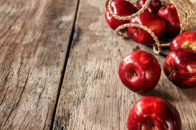 Red apples on old wooden table