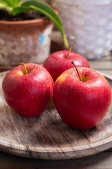 Red apples in rustic setting