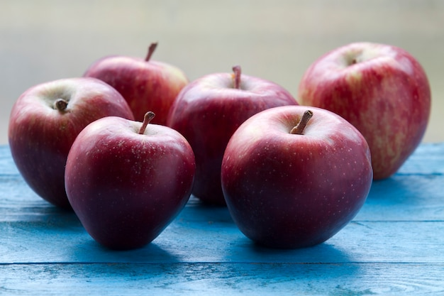 Red apples on rustic table
