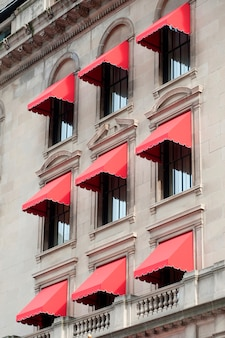 Red awnings on a building in boston, massachusetts, usa
