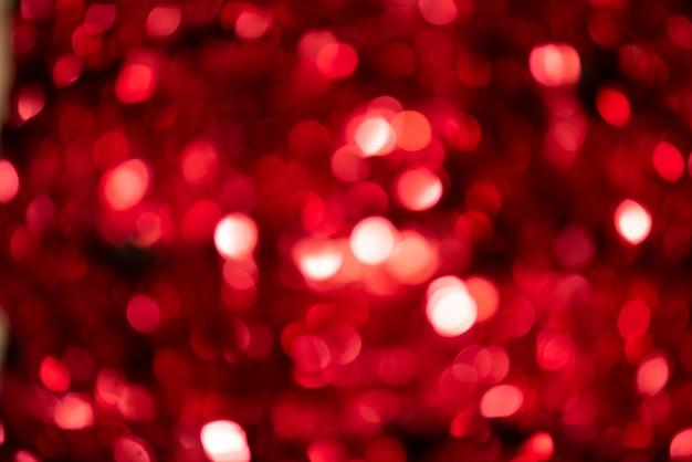 クリスマスライトの赤い背景