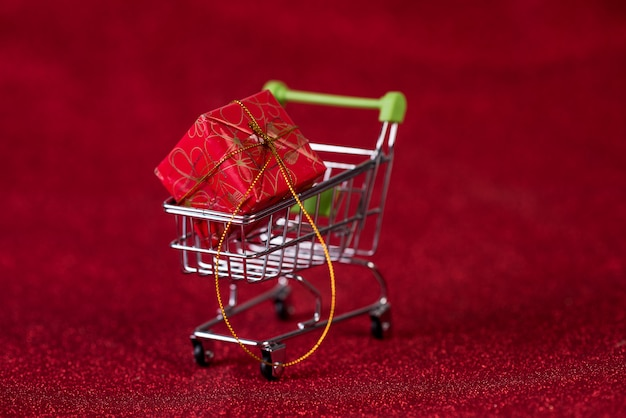 Red background and shopping trolley shopping concept and trading
