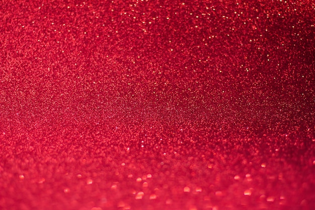 Red background with bokeh and glitter, valentine's day, christmas and new year background soft focus