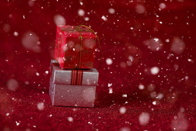 Red background with gift box and snow