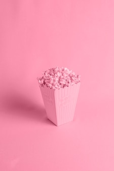 Red background with isometric popcorn