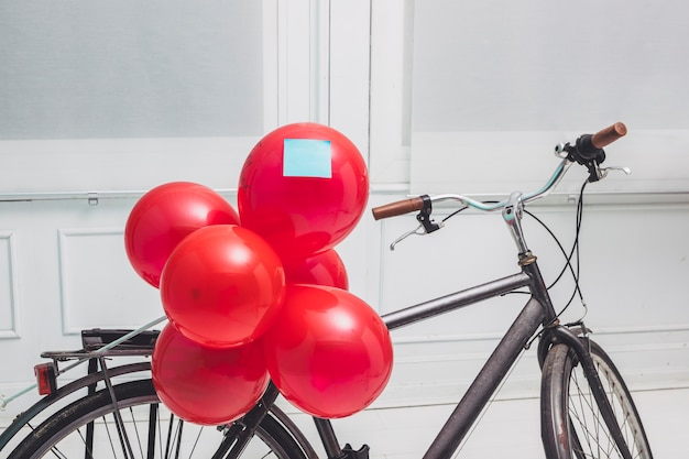 Red balloons with sticker fixed to cycle