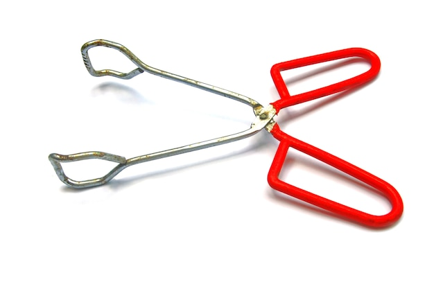 Red barbeque tongs isolated